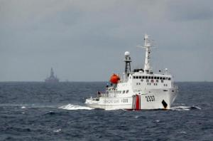 File photo of a Chinese Coast Guard vessel passing near the Chinese oil rig Haiyang Shi You 981 in the South China Sea